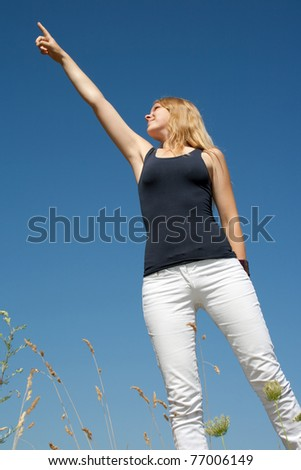 Young woman shows up - stock photo