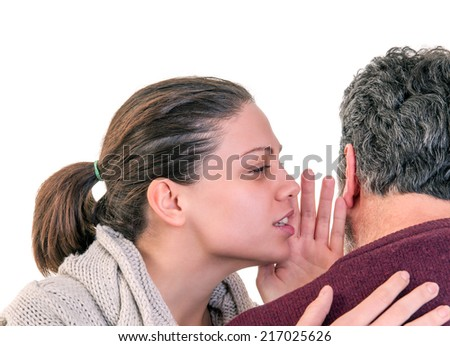 Young woman side portrait speaking in the ear of mature man showing from behind, horizontal shot over white - stock photo