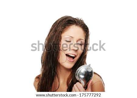 Young woman singing under shower, isolated on white - stock photo