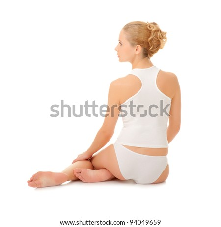 Young woman sit on the floor isolated - stock photo