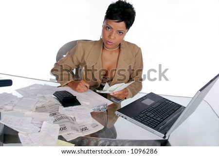 young woman sits down to begin figuring out her taxes - stock photo