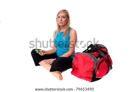 Young woman sits with tote bag before working out