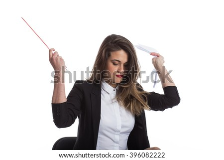Young woman sitting and throwing away papers  - stock photo