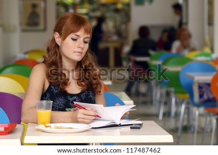 young woman sitting in a restaurant. - stock photo