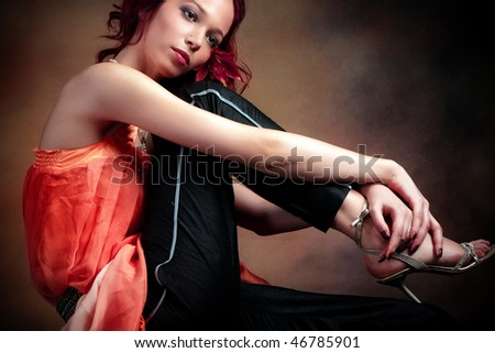 young woman sitting in fashionable clothes - stock photo