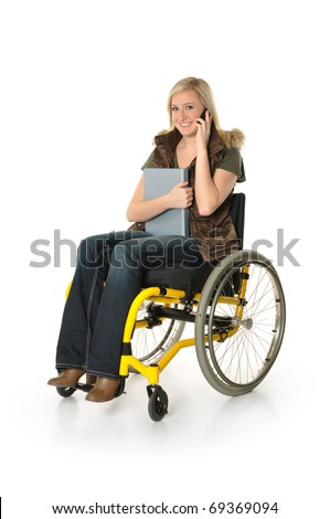 Young woman sitting in wheelchair and talking on the phone - stock photo