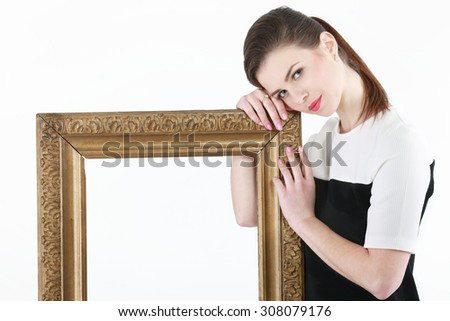 Young woman sitting near the frame