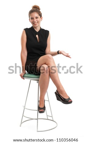 young woman sitting on a chair isolated over white background - stock photo