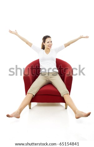 Young woman sitting on a chair on white background studio - stock photo