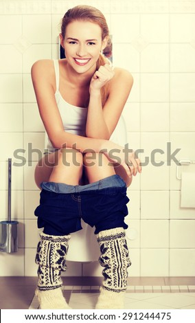 Young Woman Sitting On Toilet Stock Photo 291244475