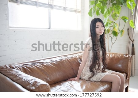 Young woman sitting on the couch