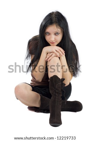 young woman sitting on the floor isolated on white - stock photo