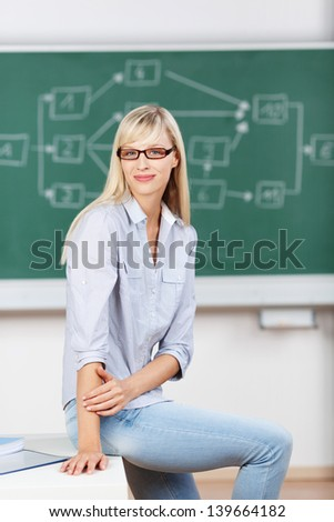 Young woman sitting over the green board background