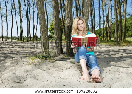 Barefoot Girl Reading A Book