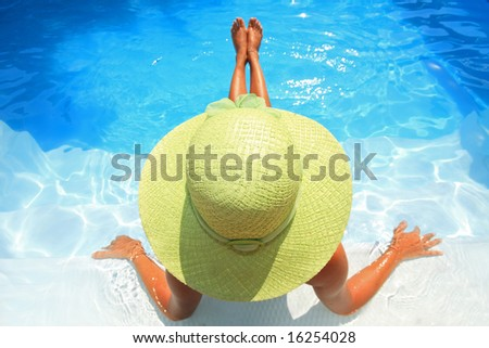 Young woman sittingin a swimming pool - stock photo