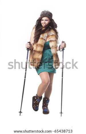 Young woman skiing in a cocktail dress, isolated on white - stock photo