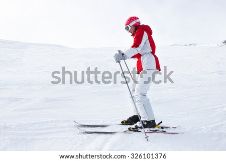 Young Woman Skiing With Ski In Snowy Landscape