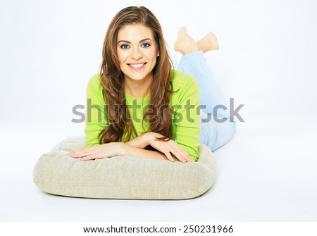 Young woman smile. Lying on floor. White background isolated. Toothy. - stock photo
