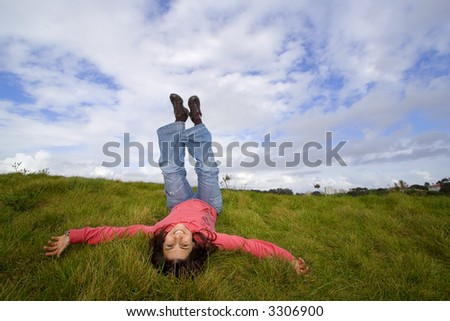 young woman smiling and having fun in outdoor park - stock photo