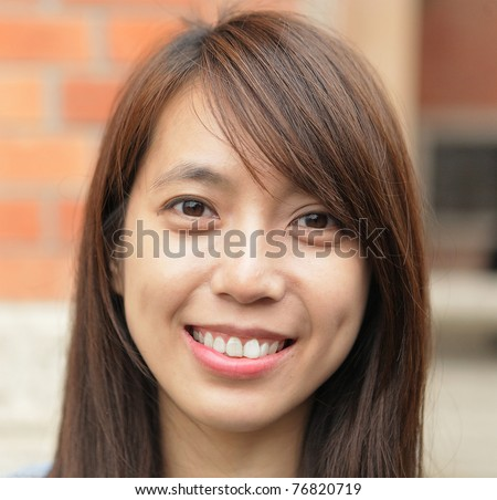 young woman smiling friendly - stock photo