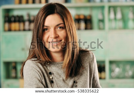 Young woman smiling in a pub