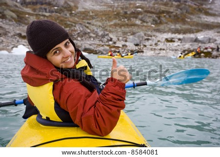 young woman smiling in kayak - stock photo