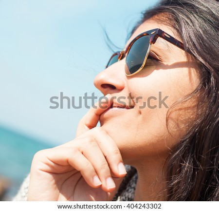 young woman smiling in the beach - stock photo