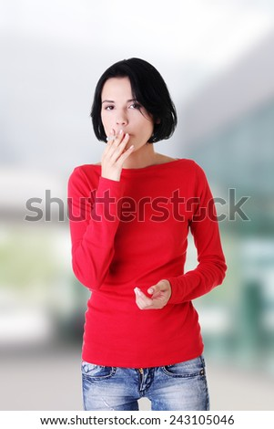 Young woman smoking electronic cigarette. - stock photo