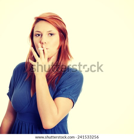 Young woman smoking electronic cigarette ,ecigarette - stock photo