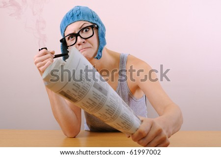 Young woman smoking pipe in studio. - stock photo