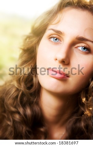 Young woman soft portrait. Bright sunlight.