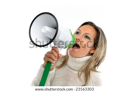 young woman speaking through megaphone - stock photo
