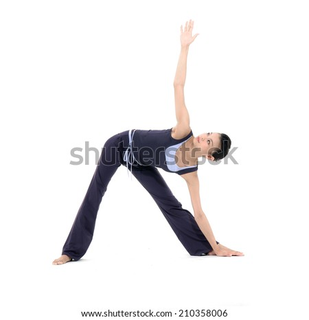 Young woman stand in yoga asana - half moon pose - stock photo