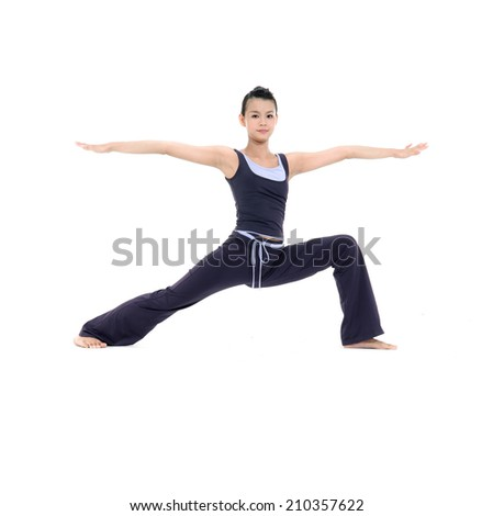 young woman stand in yoga pose - stock photo