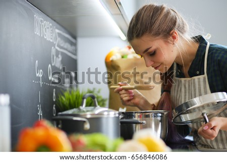 Young Woman Standing By Stove Kitchen Stock Photo 309513500 ...