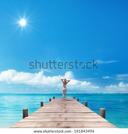 Young woman standing on boardwalk Caribbean sea 3D - stock photo
