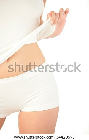 Young woman standing/part of body isolated on white background - stock photo