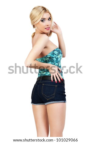 Young woman standing with his back to the denim shorts. - stock photo