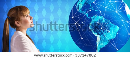 Young woman stands near big earth ball on the blue rombus background. Elements of this image furnished by NASA - stock photo