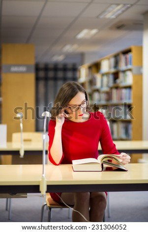 Young woman start reading fat book with glasses