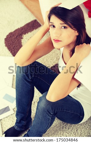 Young woman stressed because of high bills.  - stock photo