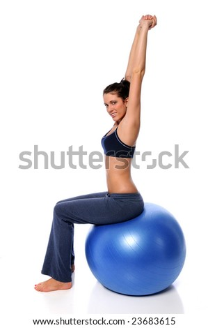 Young woman stretching sitting on exercise ball