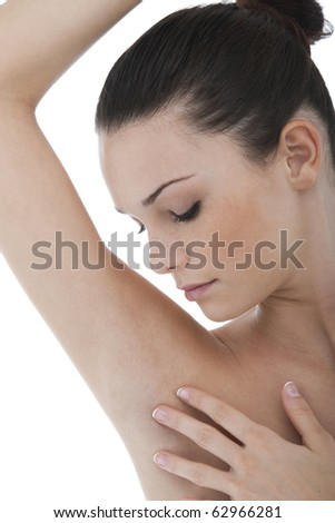 Young woman stroking her clean armpit - stock photo