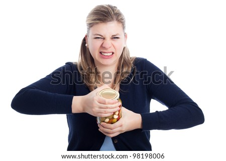 Young woman struggling to open bottle, isolated on white background. - stock photo