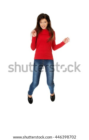 Young woman student jumping.  - stock photo