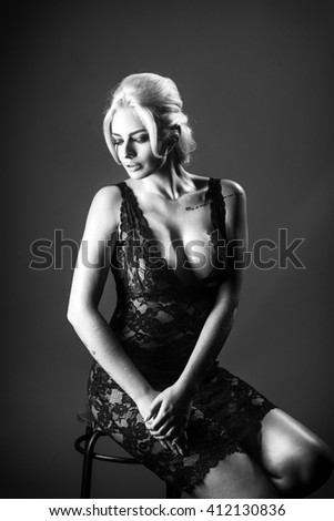 Young woman studio fashion portrait. Black and white. - stock photo
