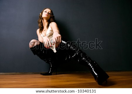 Young woman studio glamour photo. Buttom wide angle view. - stock photo