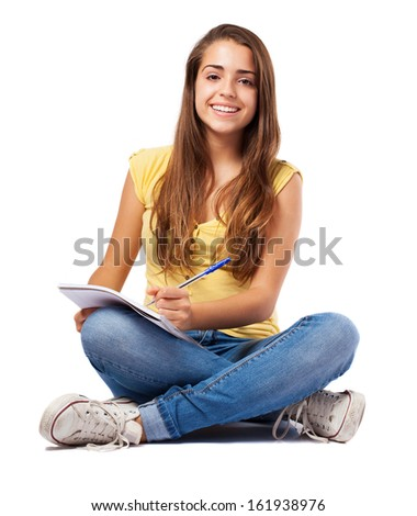 young woman studying and doing homework on white - stock photo