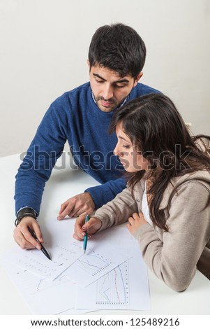 Young Woman Studying with Her Tutor - stock photo