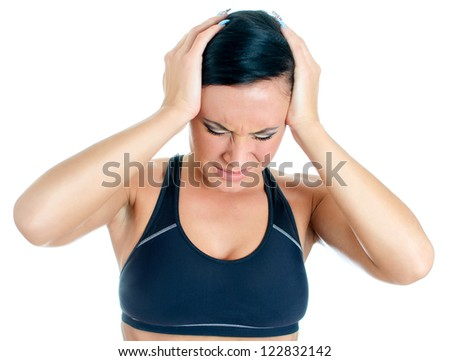 Young woman suffering from headache. Isolated on white - stock photo